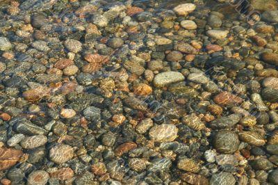Low tide ripples, granite pebbles
