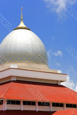 Dome and Red Roof of a Mosque