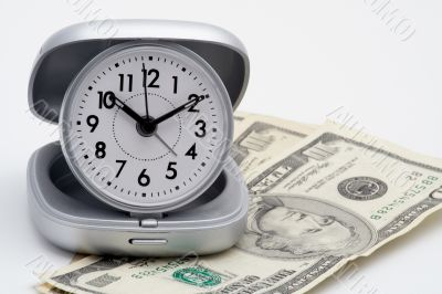 Clock and money (dollars)