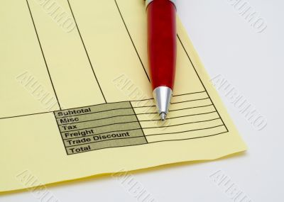 Blank invoice with pen