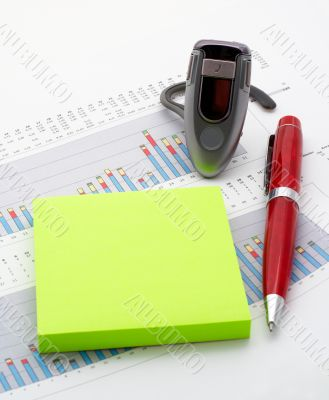Handsfree, notes and pen on earnings chart background