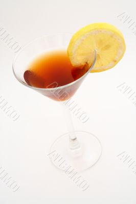 Red cocktail with lemon
