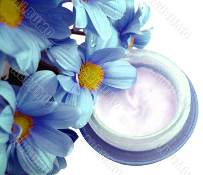 blue container of cosmetic moisturizing cream with flowers
