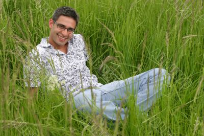 Smiling young man in the grass
