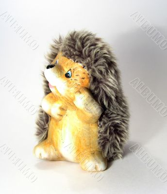 Funny toy of little fluffy hedgehog