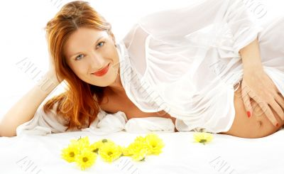 smiling pregnant beauty with flowers