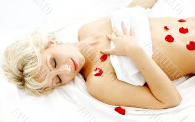 blond with rose petals in spa