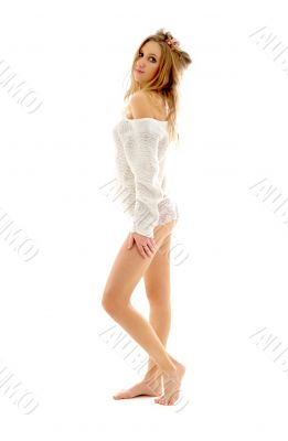 barefoot blond in white sweater