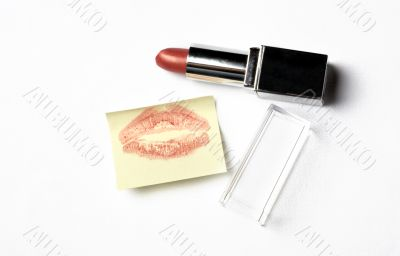red lipstick and yellow sticker note with kiss