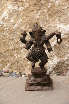 Bronze Ganesha dancing, on granite