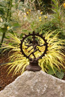 Bronze Shiva in garden