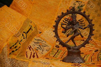 Bronze Shiva on yellow - orange