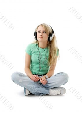 teenage girl in headphones sitting on the floor