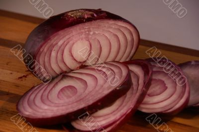 Sliced red onion displayed