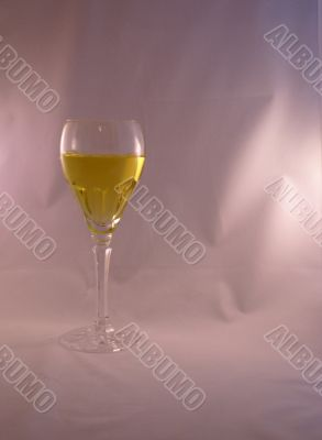 Crystal wine goblet with white wine