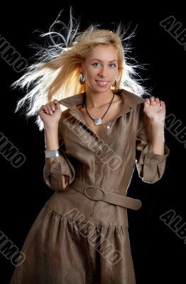 dancing blond in brown dress