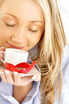 blond with cup of coffee and chocolate