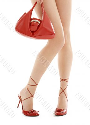 long legs on high heels and red purse