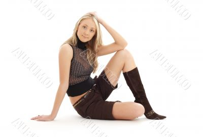 sitting blond in brown shorts and boots