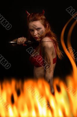 dark red devil girl with a knife in fire