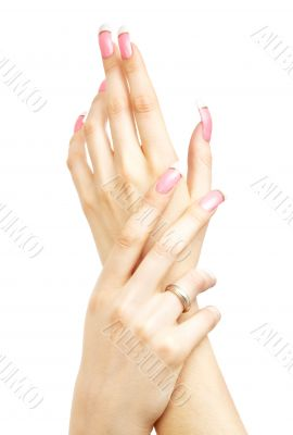 two hands with pink acrylic nails