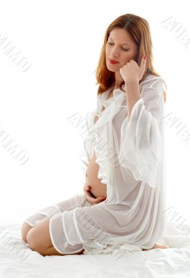 pregnant redhead in transparent sleepwear
