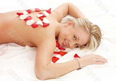girl with heart-shaped petals in massage salon
