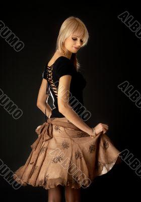 dancing blond in brown skirt