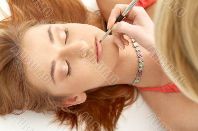 redhead laying at professional makeup studio