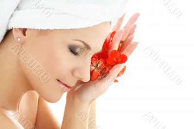 happy woman with red flower petals