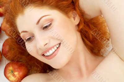 lovely redhead with red apples