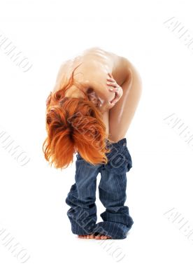 naked redhead in blue jeans over white