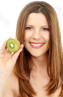 beautiful brunette showing fresh kiwi