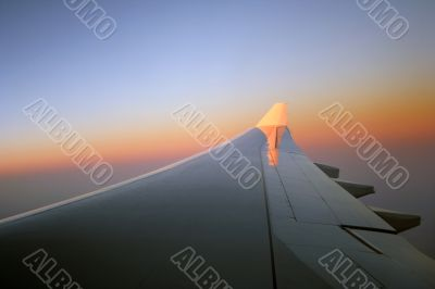 Sunrise over the aeroplane wing