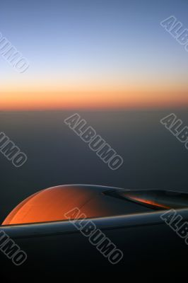 Sunrise over the aeroplane engine