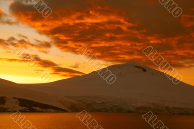 Fiery sunset over icy mountain