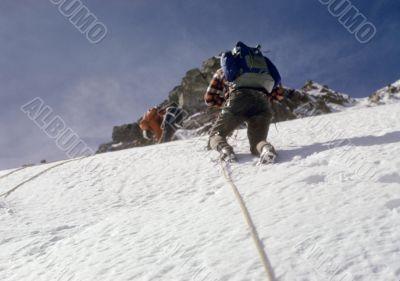 Climbers on steep snow face