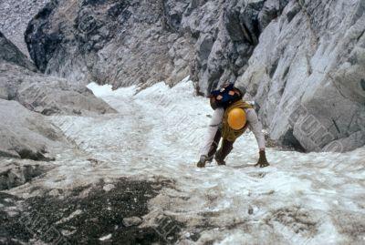 Climber on steep ice couloir