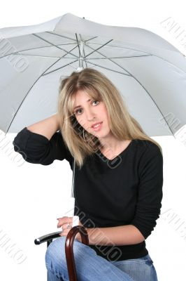 Beauty blonde girl with an umbrella