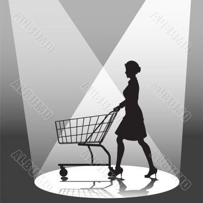 Woman Shopper & Shopping Cart in Spotlight
