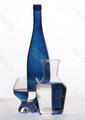 blue bottle and glasses