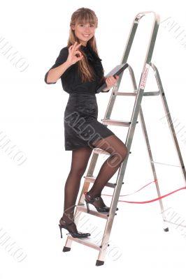business woman climbing ladder