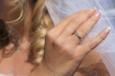 Hand touching a bridal veil