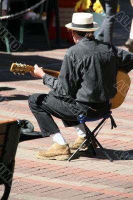 Street musician, guitar