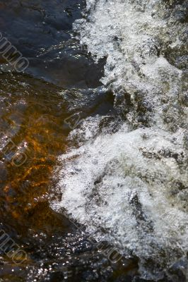 little rapids and spray in a small creek