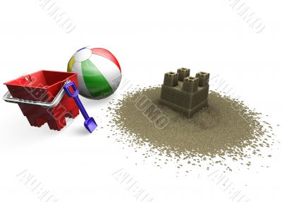 Sandcastle with beach ball, bucket and spade