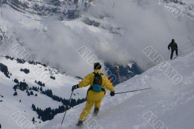 Yellow skier traversing steep slope