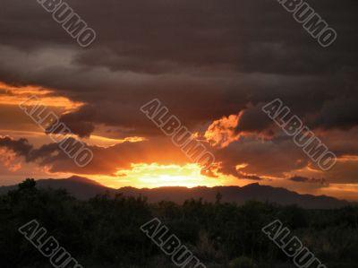 Sunset glowing up thru Rainclouds