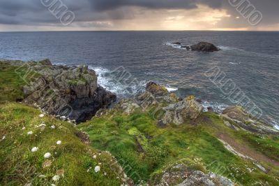 green coastline at dusk