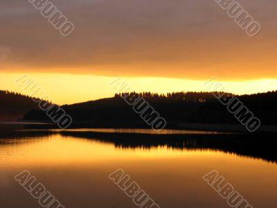 Orange sunset mirrorred in water